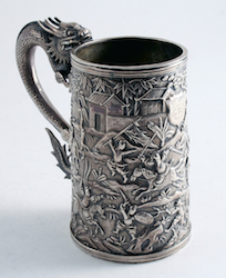 Mug with dragon handle and chased decoration