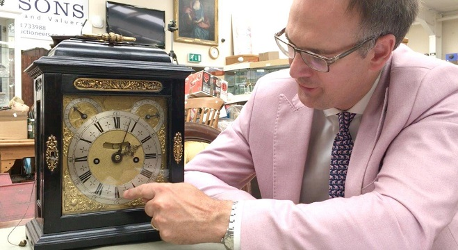 Charles Hanson with the Thomas Tompion clock in recent sale