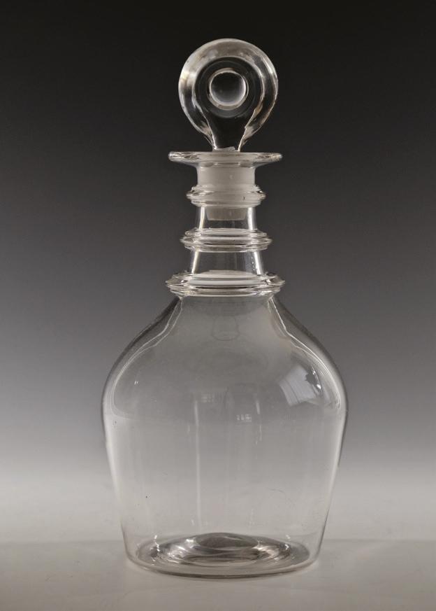 Bullseye stopper in an antique glass decanter