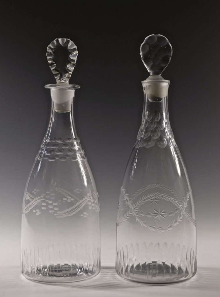 Lozenge stoppers in antique glass decanters