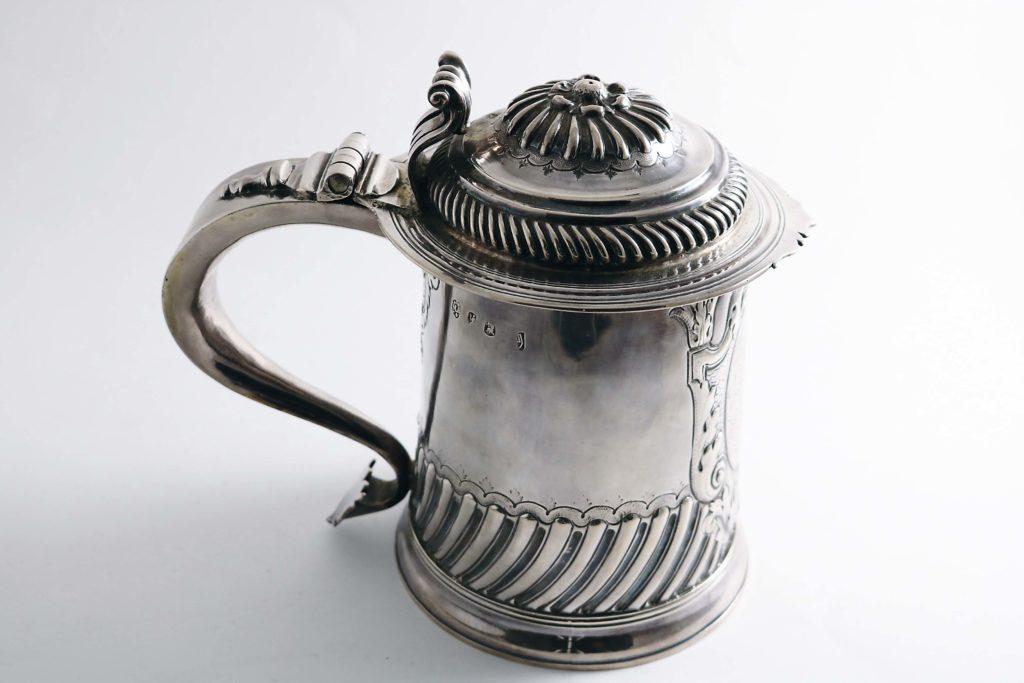 A silver Queen Anne tankard