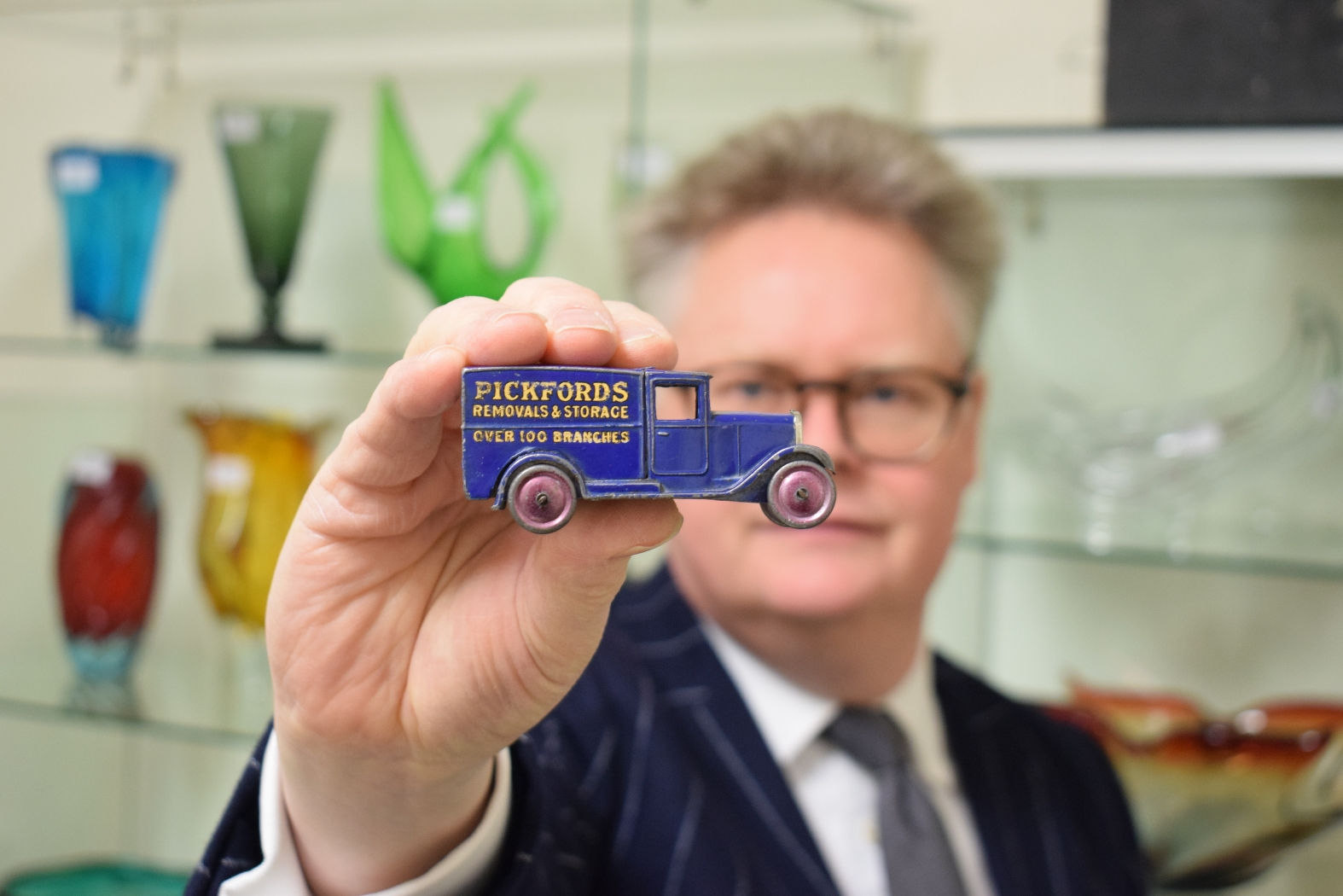 Auctioneer with Dinky Toys van