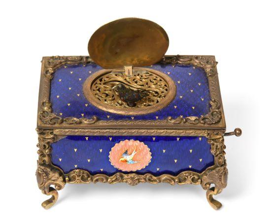 A gilt and enamel singing bird box