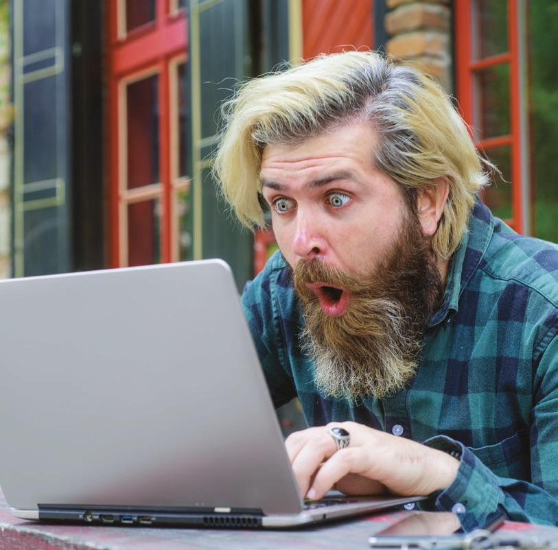 Man taking part in online auction