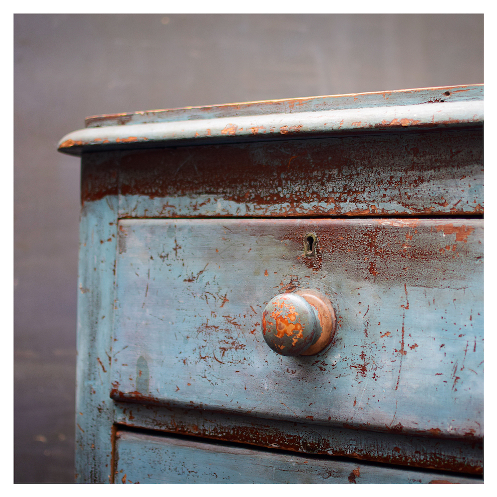 An antique chest of drawers