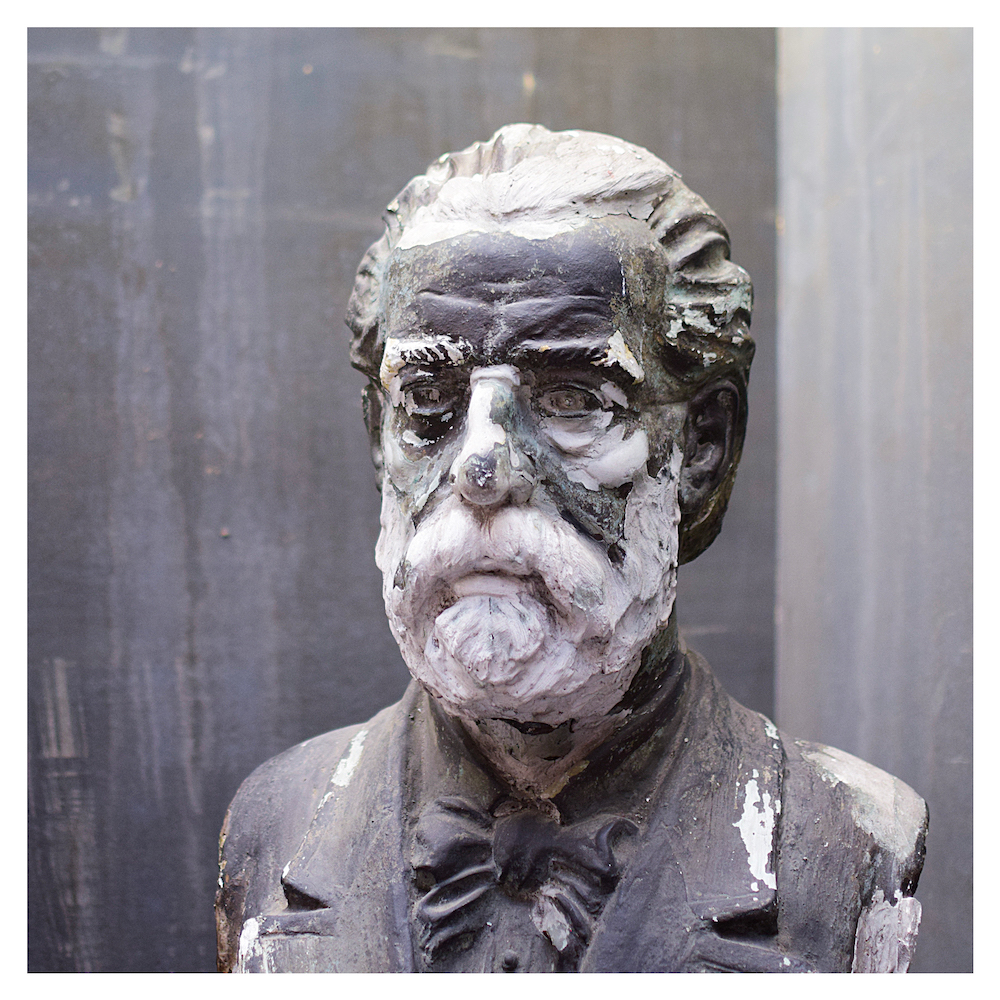 A patinated antique statue bust