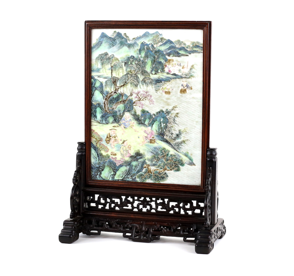 A wood-mounted famille-rose table screen, from the Qing Dynasty period