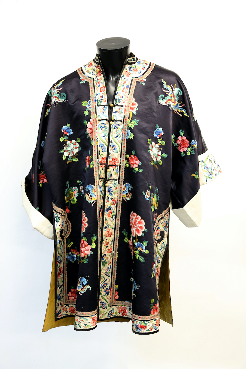 An elegant Chinese textile jacket with imperial yellow lining and white ground cuffs