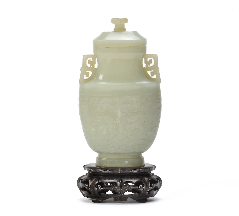 A Chinese pale celadon jade archaistic vase and cover, Qing Dynasty