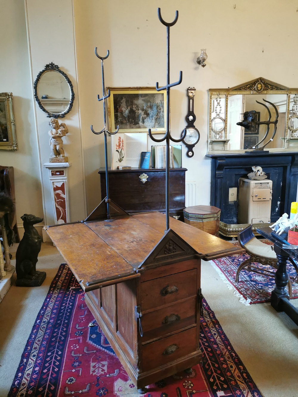 Rare late 19th century pitch pine estate tack stand, complete with metal harness hangers, originally from a country house in County Waterford, made by Musgrave & Co, Belfast, London & Paris.