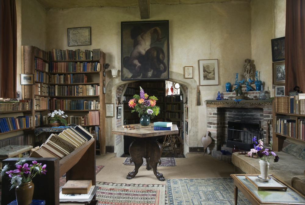 The Writing Room, looking towards the fireplace and hexagonal table, in the Tower at Sissinghurst, home of Vita Sackville-West and her husband Sir Harold Nicolson, near Cranbrook, Kent. This room was Vita's sanctum where she wrote her books, poetry and gardening articles.
