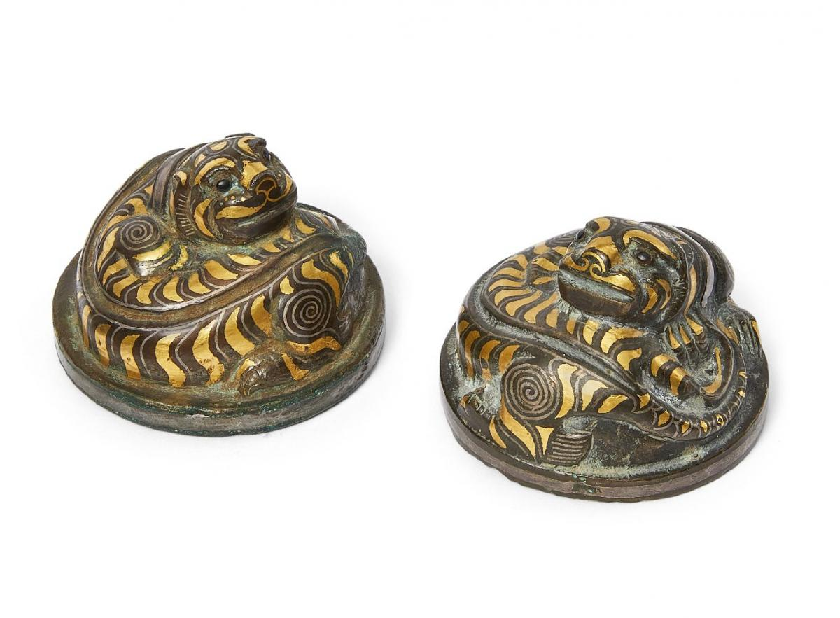 Pair of Chinese bronze and inlaid 'tiger' mat weights, Western Han dynasty