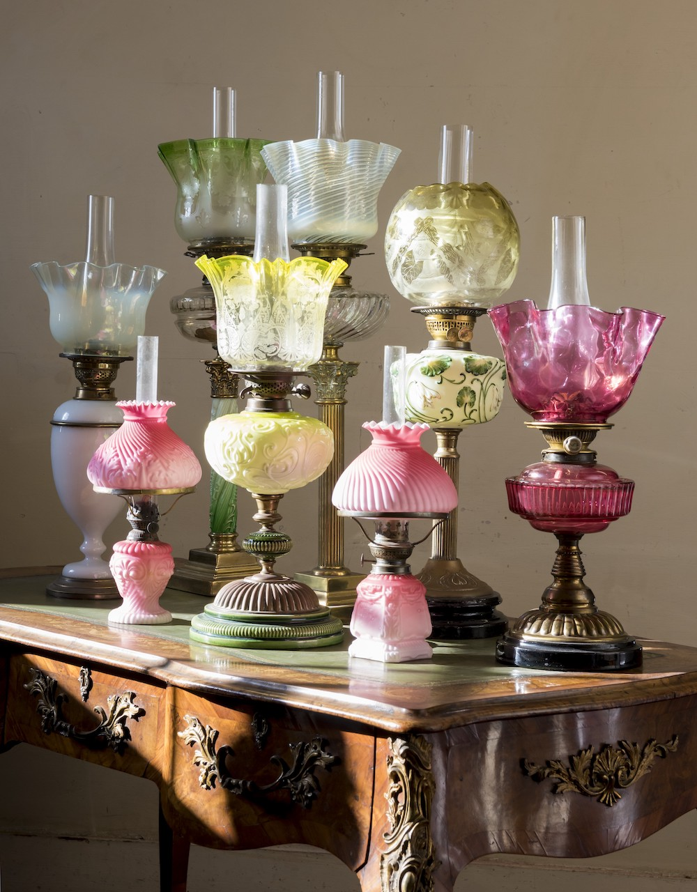 A group of eight Victorian clear and frosted glass oil lamps
