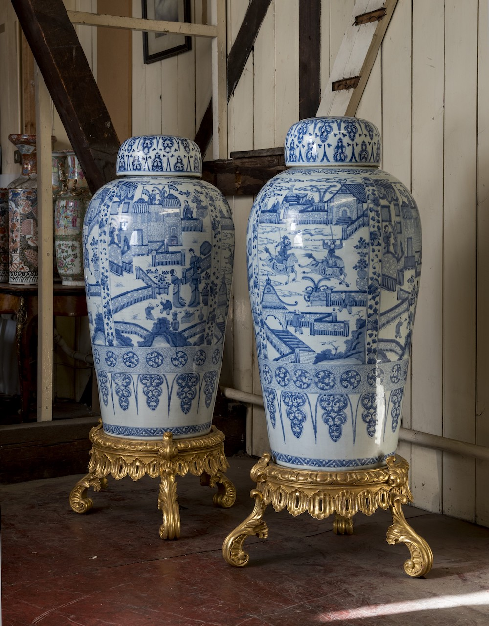 A pair of Chinese Kangxi blue and white 'soldier' vases and covers, on giltwood stands (estimate £100,000-150,000)