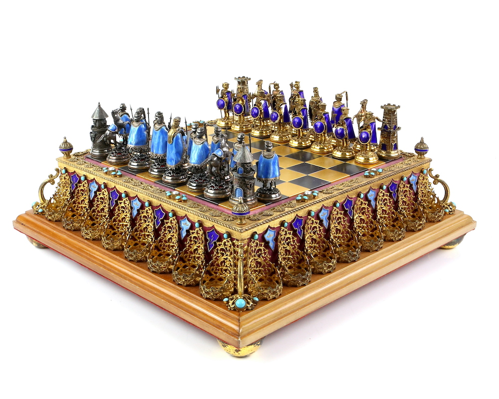 A fine late 19th century or early 20th century Austro-Hungarian silver, silver gilt and enamel chess set and board