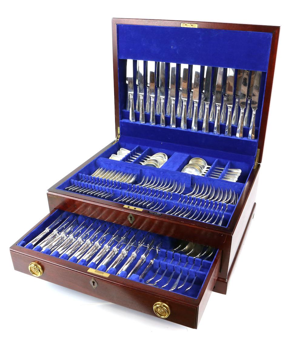 An Elizabeth II twelve place silver table service, by Mappin & Webb