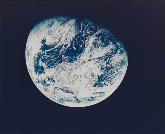 First photograph of the Earth taken by a human from beyond the Earth's orbit