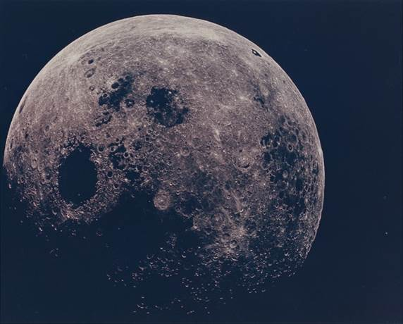 Photograph of the near-full Moon as witnessed by the Apollo 8 crew during homebound journey