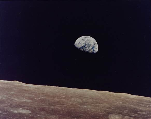 The first colour photograph of the Earth rising above the Moon's horizon. Estimated at £3,000-5,000