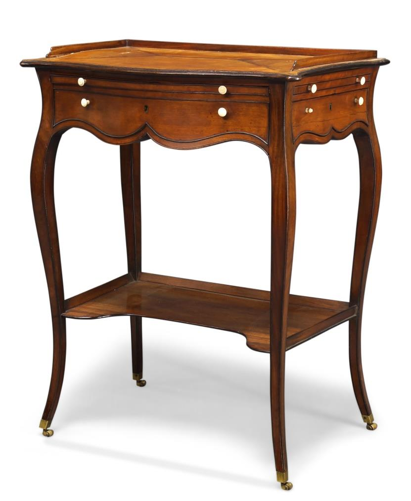 George III satinwood and crossbanded serpentine writing table, to a design by Thomas Chippendale