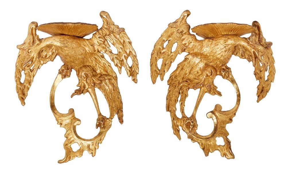 A pair of George II giltwood and gesso Ho-Ho bird wall brackets