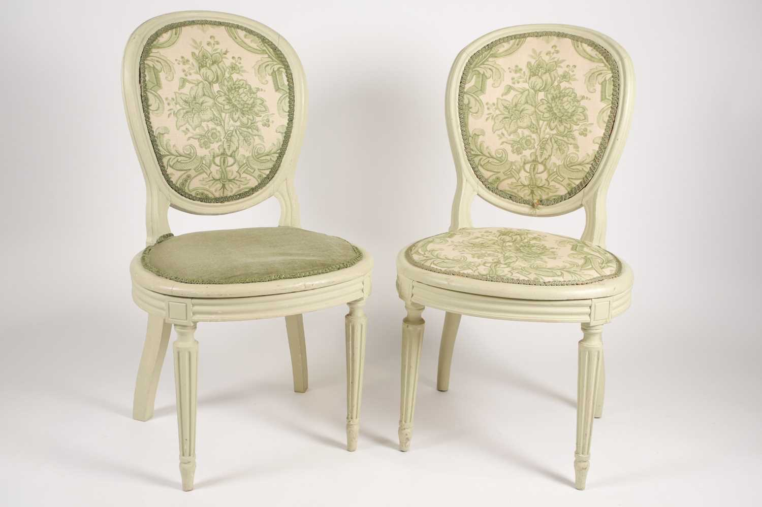 pair of green painted salon/dining chairs made by Waring & Gillow