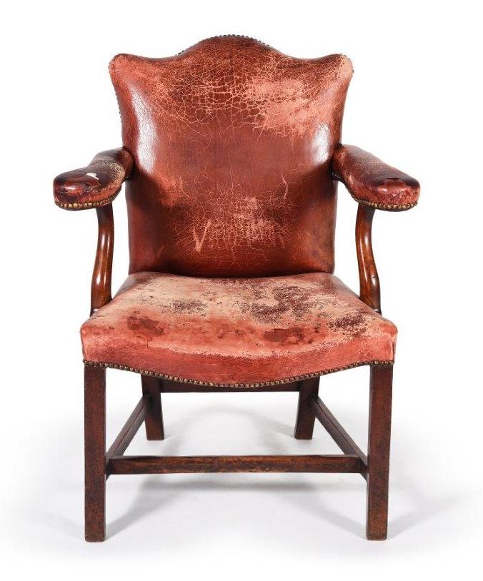 A George III mahogany and leather upholstered armchair
