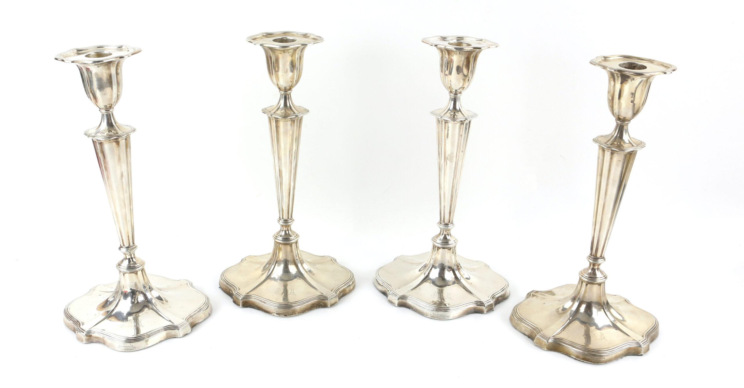 A set of four George V silver candlesticks