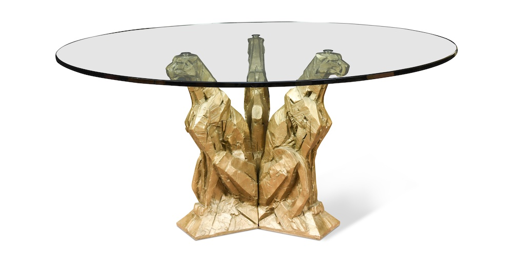 Dylan Lewis glass-topped table featuring three seated cheetahs