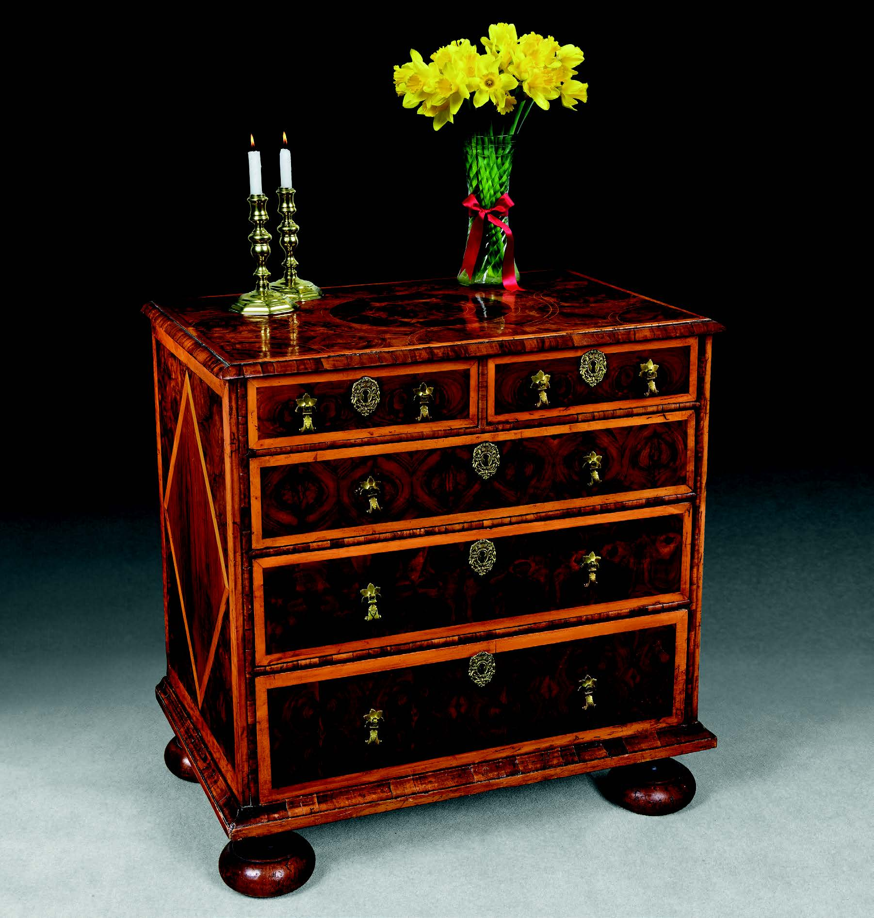 A Queen Anne oyster-veneered chest of drawers, c. 1700