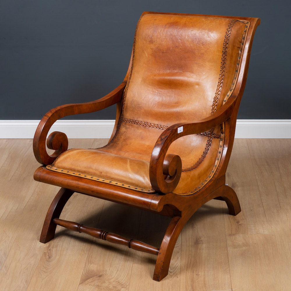 Late Victorian walnut and leather upholstered armchair