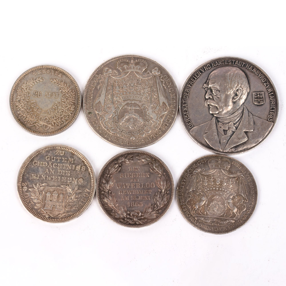 a collection of German coins and medallions
