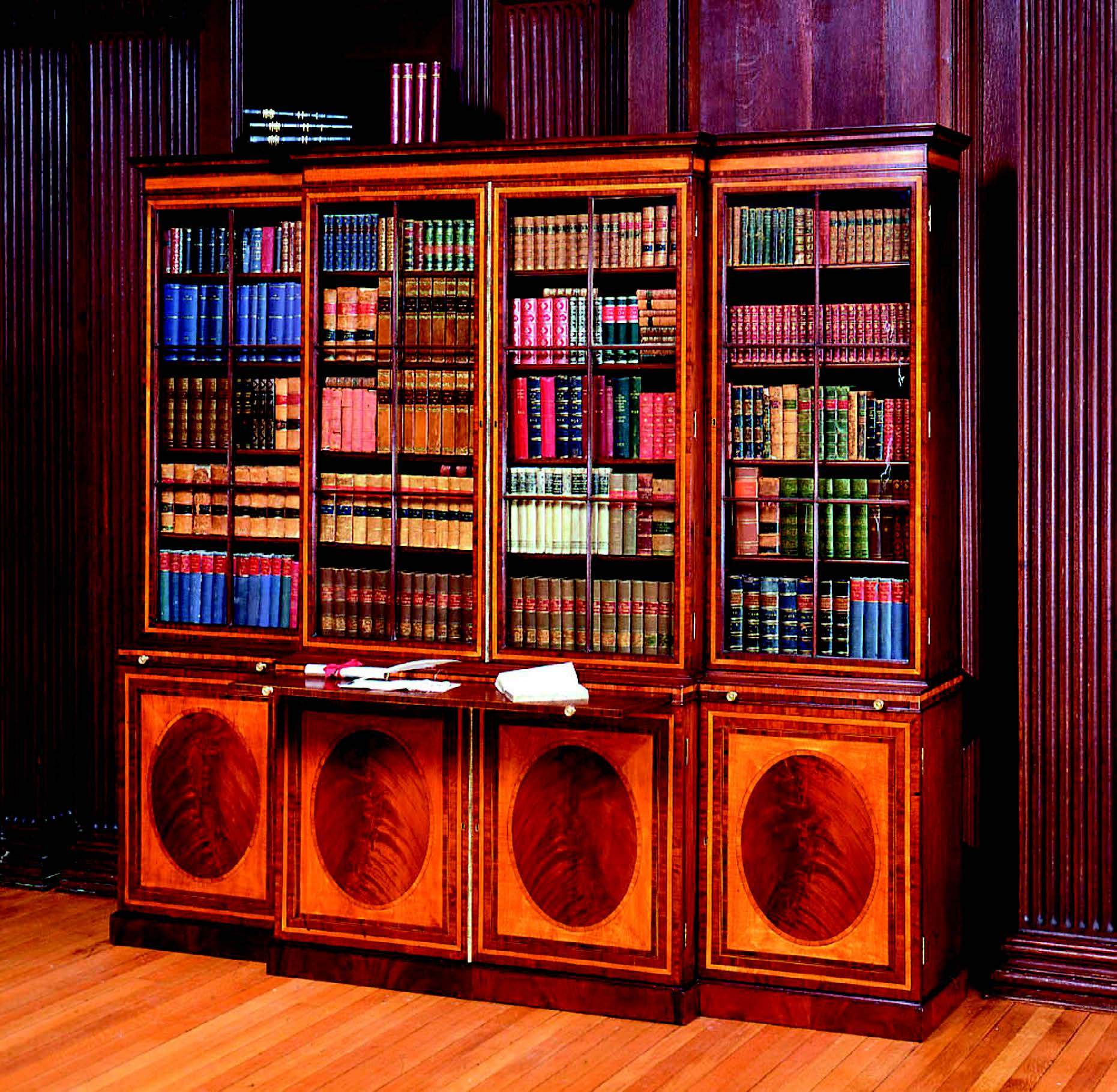 An antique George III breakfront library bookcase