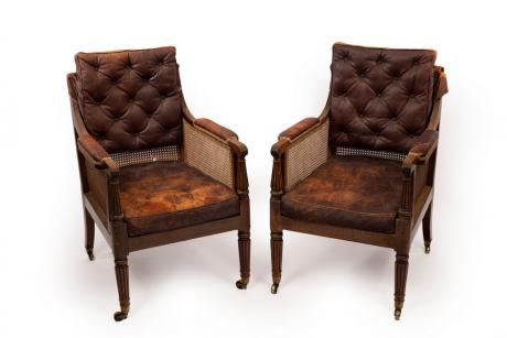 A pair of William IV mahogany library bergère armchairs