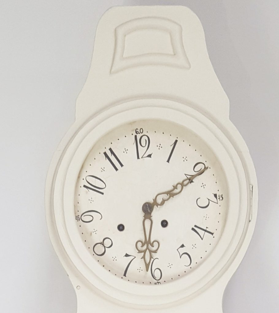 Clock face of a Swedish antique Mora clock