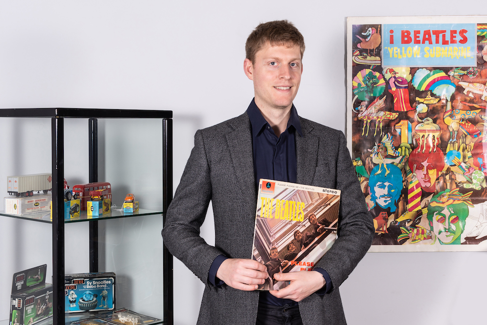 Vintage toy expert Andrew  with a copy of The Beatles Please Please Me
